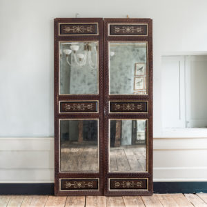 Pair of carved hardwood and mirrored door panels,