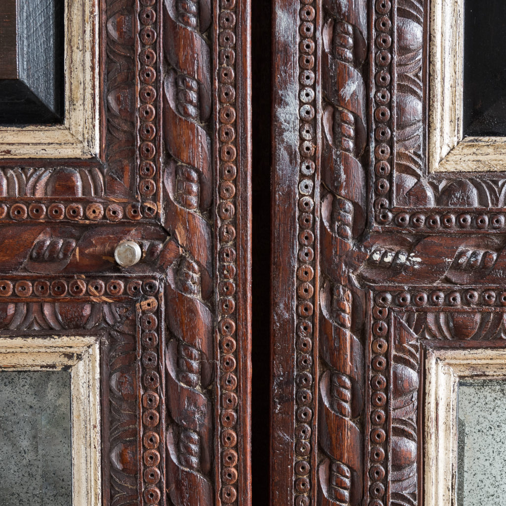 Pair of carved hardwood and mirrored door panels,-139977