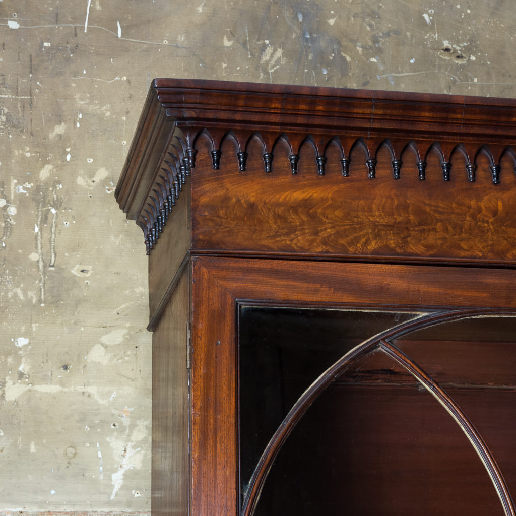 the moulded cornice above frieze hung with gothic pendants