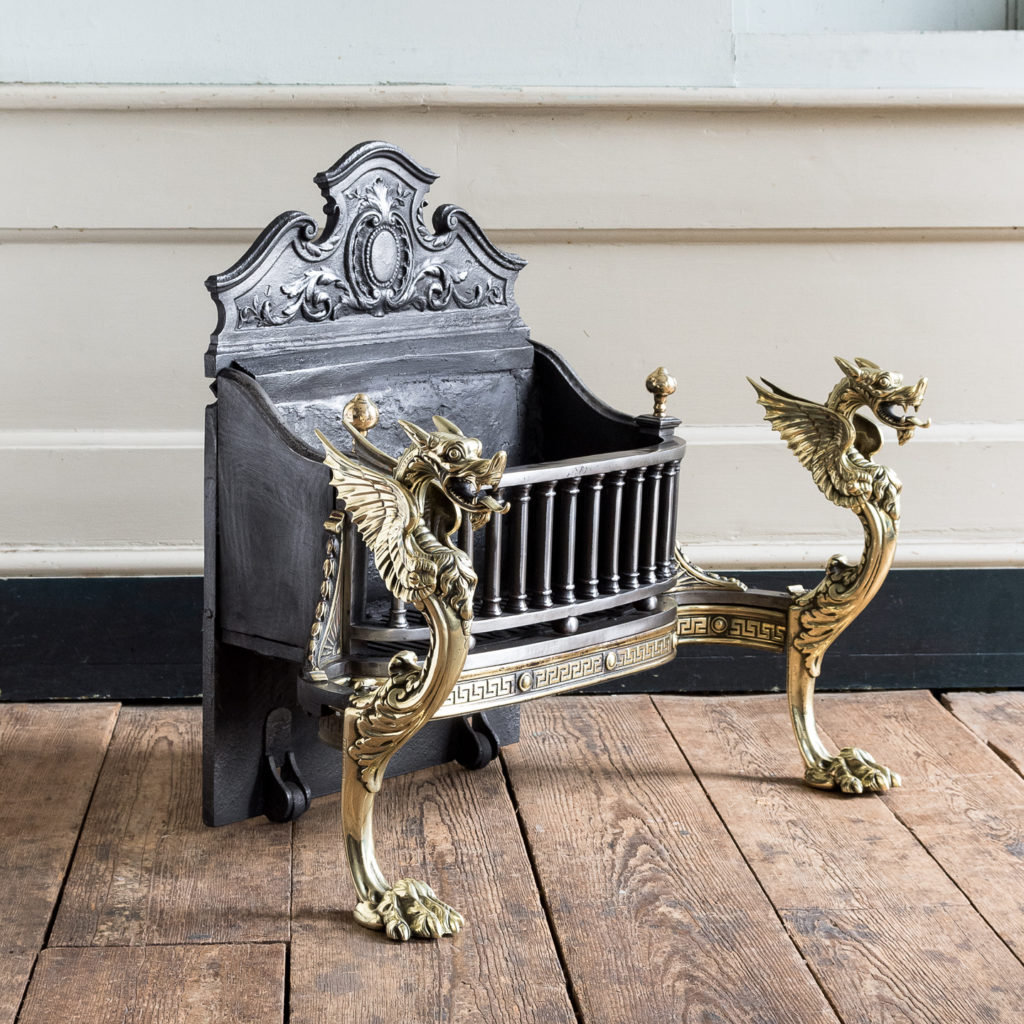 Victorian iron and brass Griffin fire grate,
