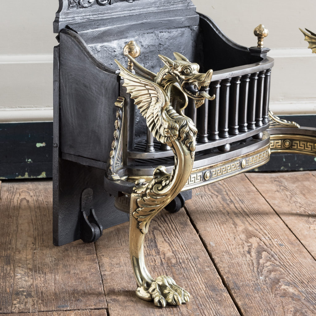 cast brass Griffin monopodia with hairy paw feet.