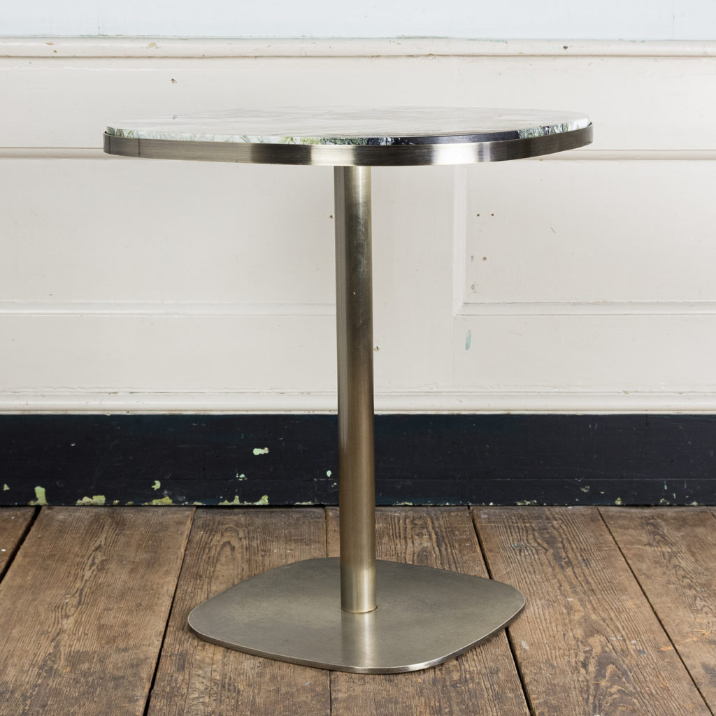 Brushed steel and marble restaurant tables,-139866