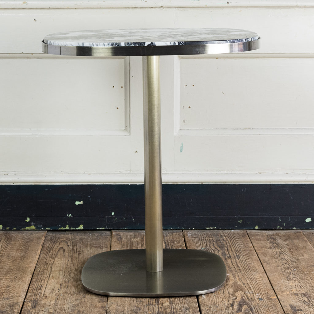 Brushed steel and marble restaurant tables,-139883
