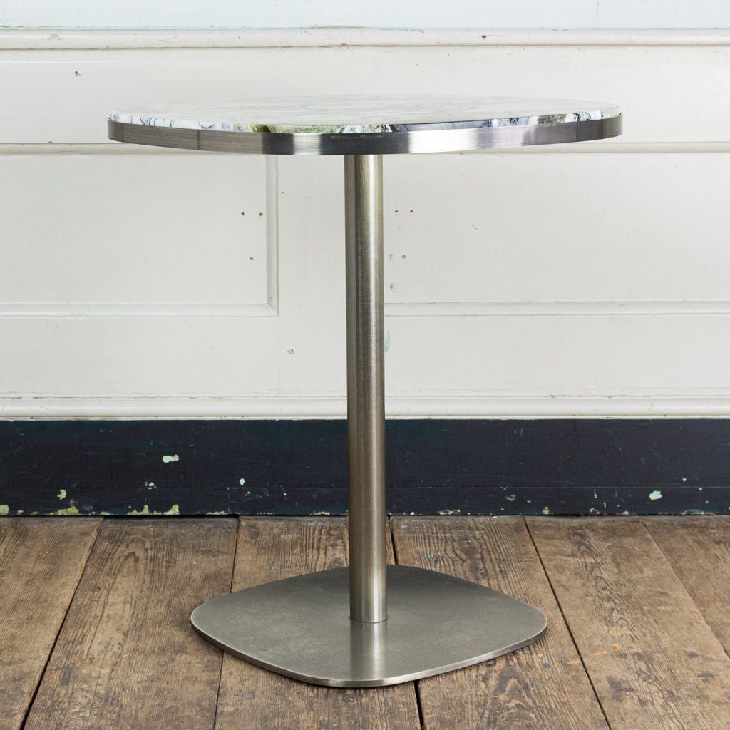 Brushed steel and marble restaurant tables,-139898