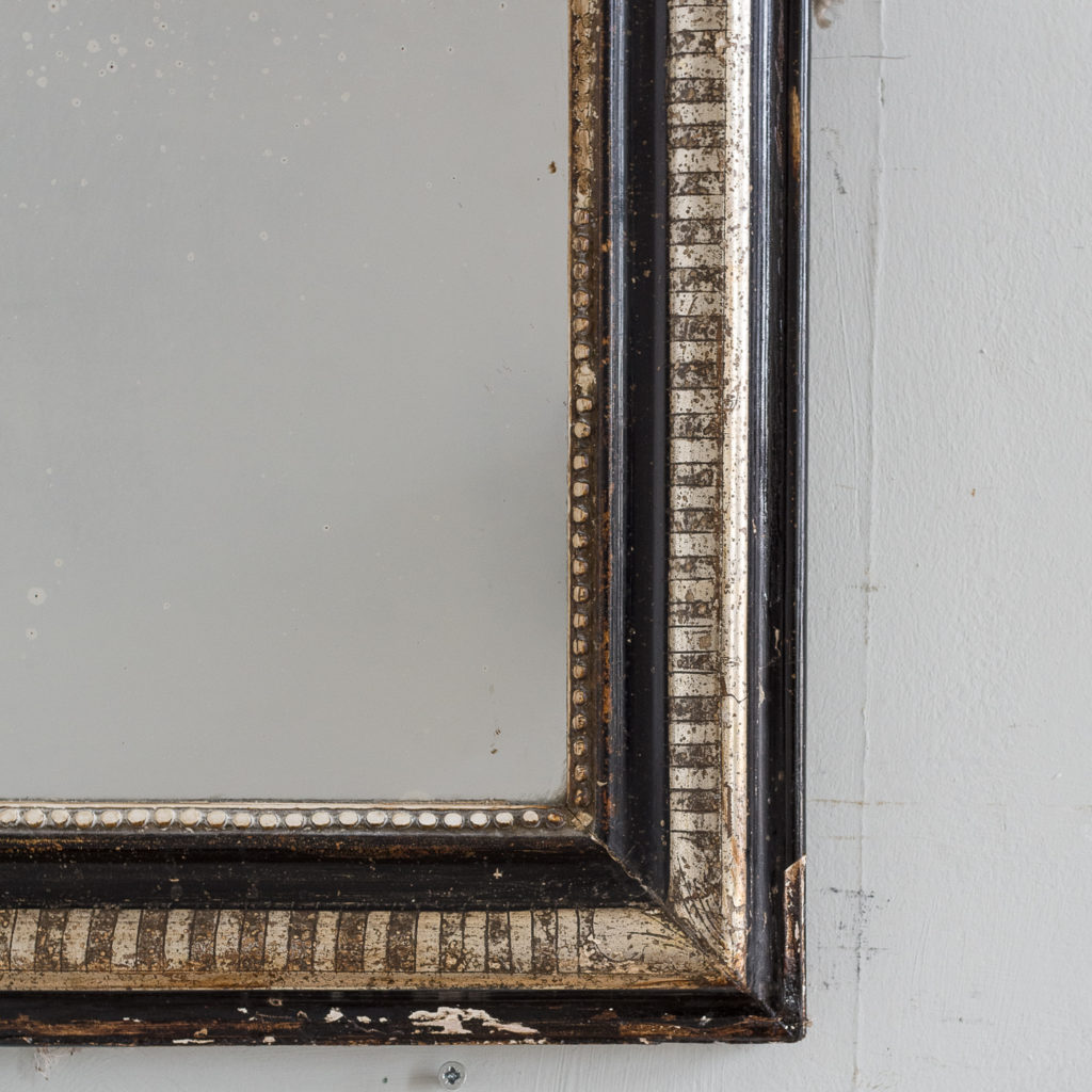 French ebonised and parcel silver-gilt wall mirror,-139997