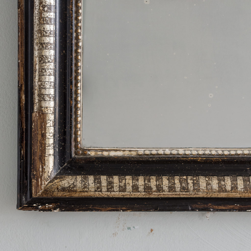 French ebonised and parcel silver-gilt wall mirror,-139999