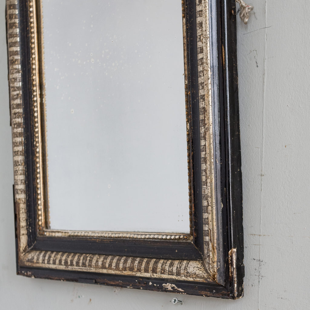 French ebonised and parcel silver-gilt wall mirror,-139998