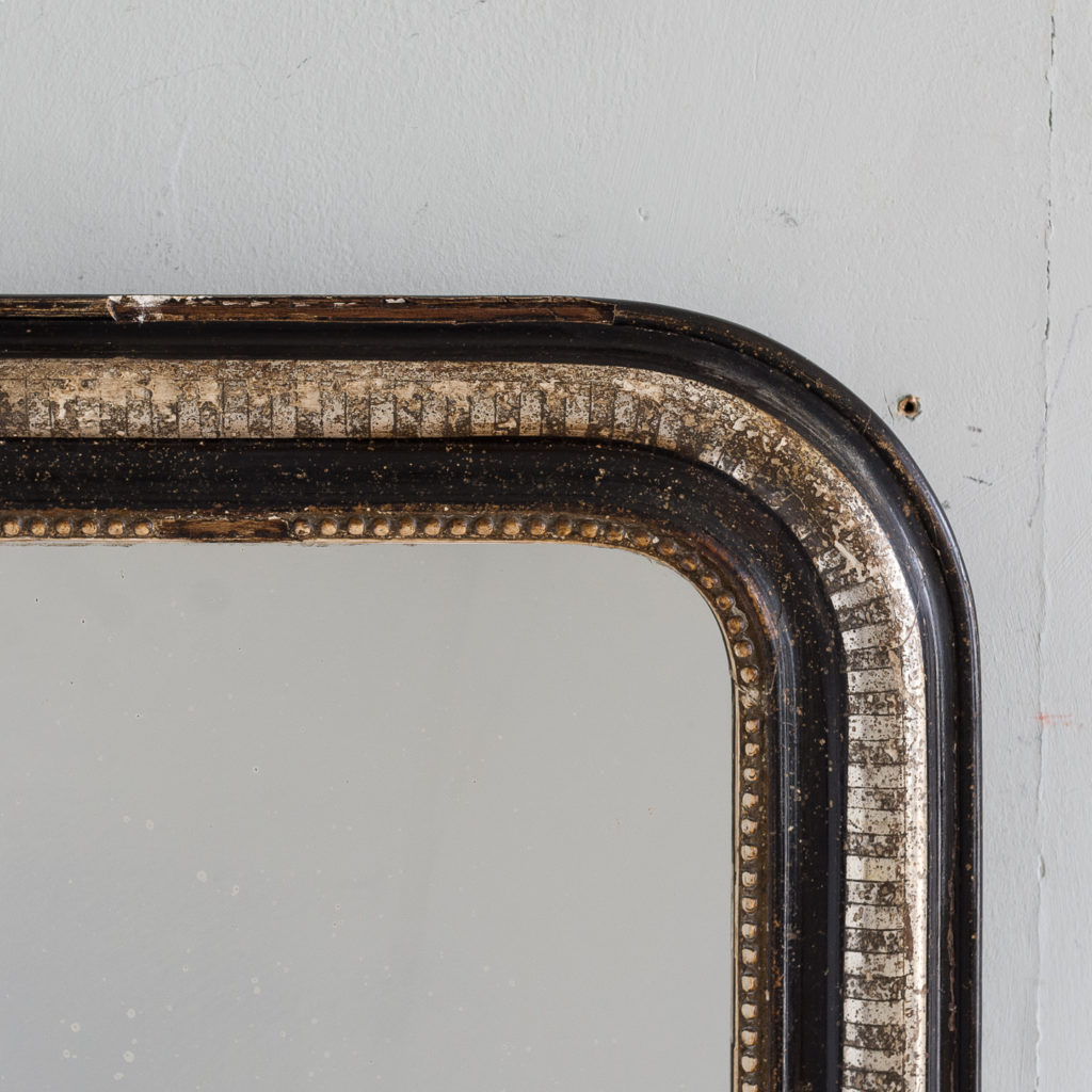 French ebonised and parcel silver-gilt wall mirror,-140000