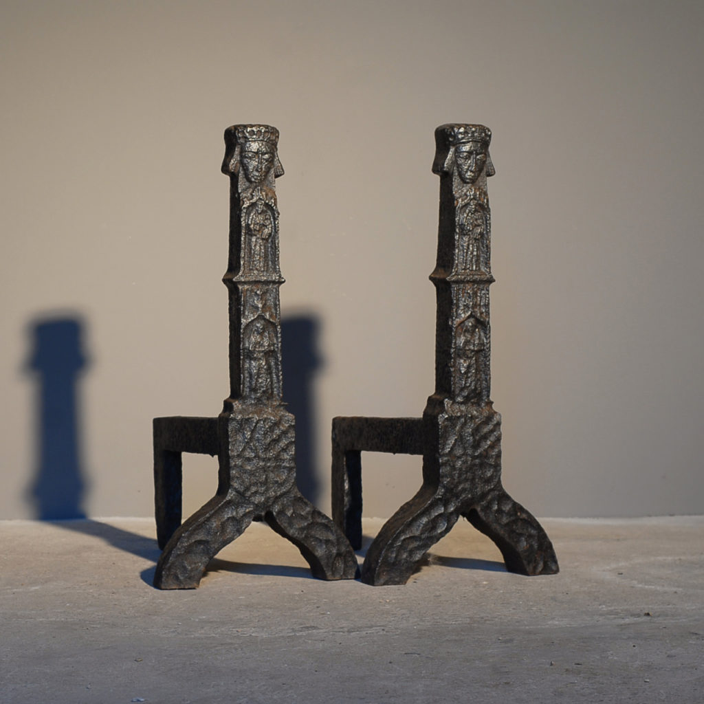 A substantial pair of cast iron andirons-0