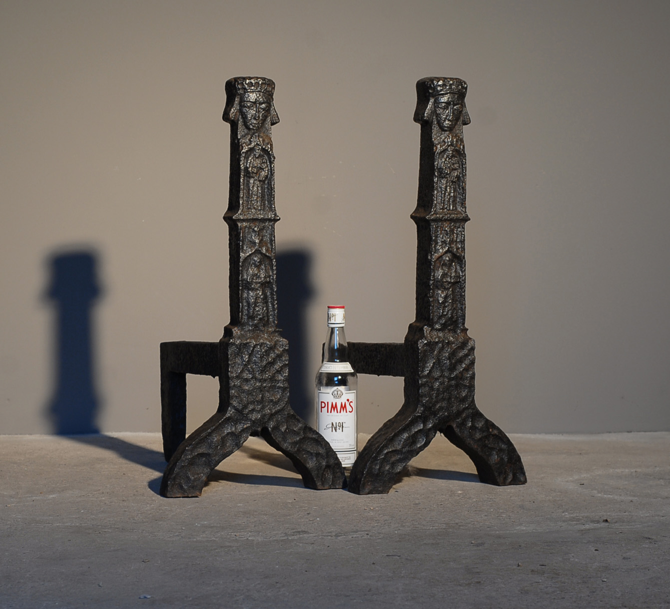A substantial pair of cast iron andirons-140649