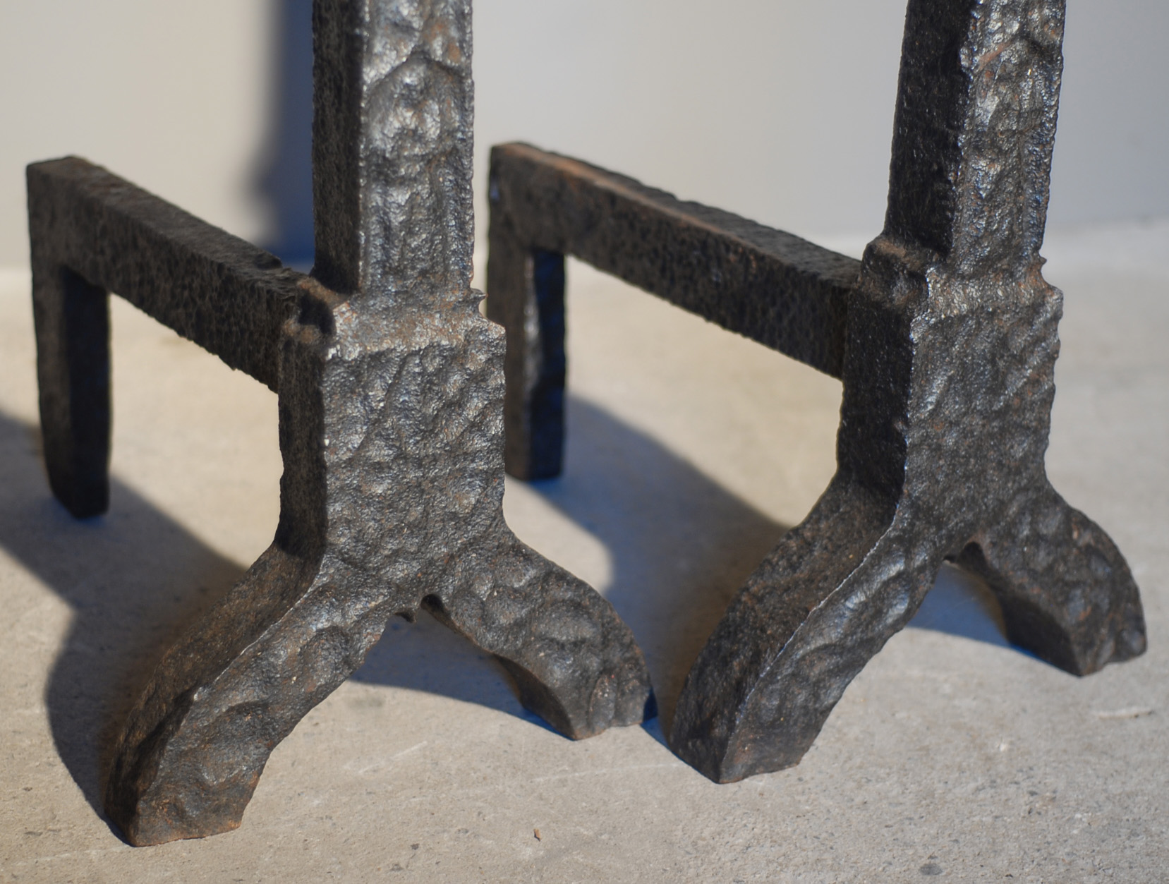 A substantial pair of cast iron andirons-140650