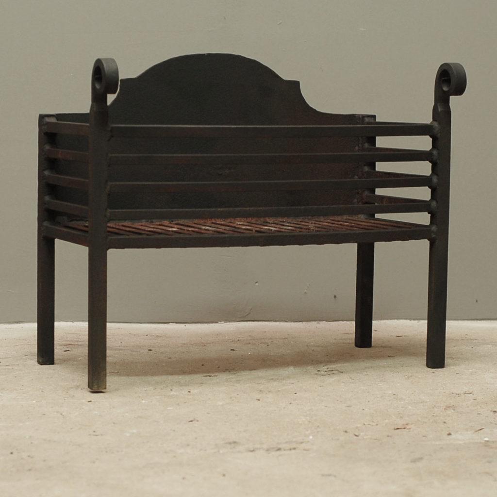 A large welded steel fire basket,-140651