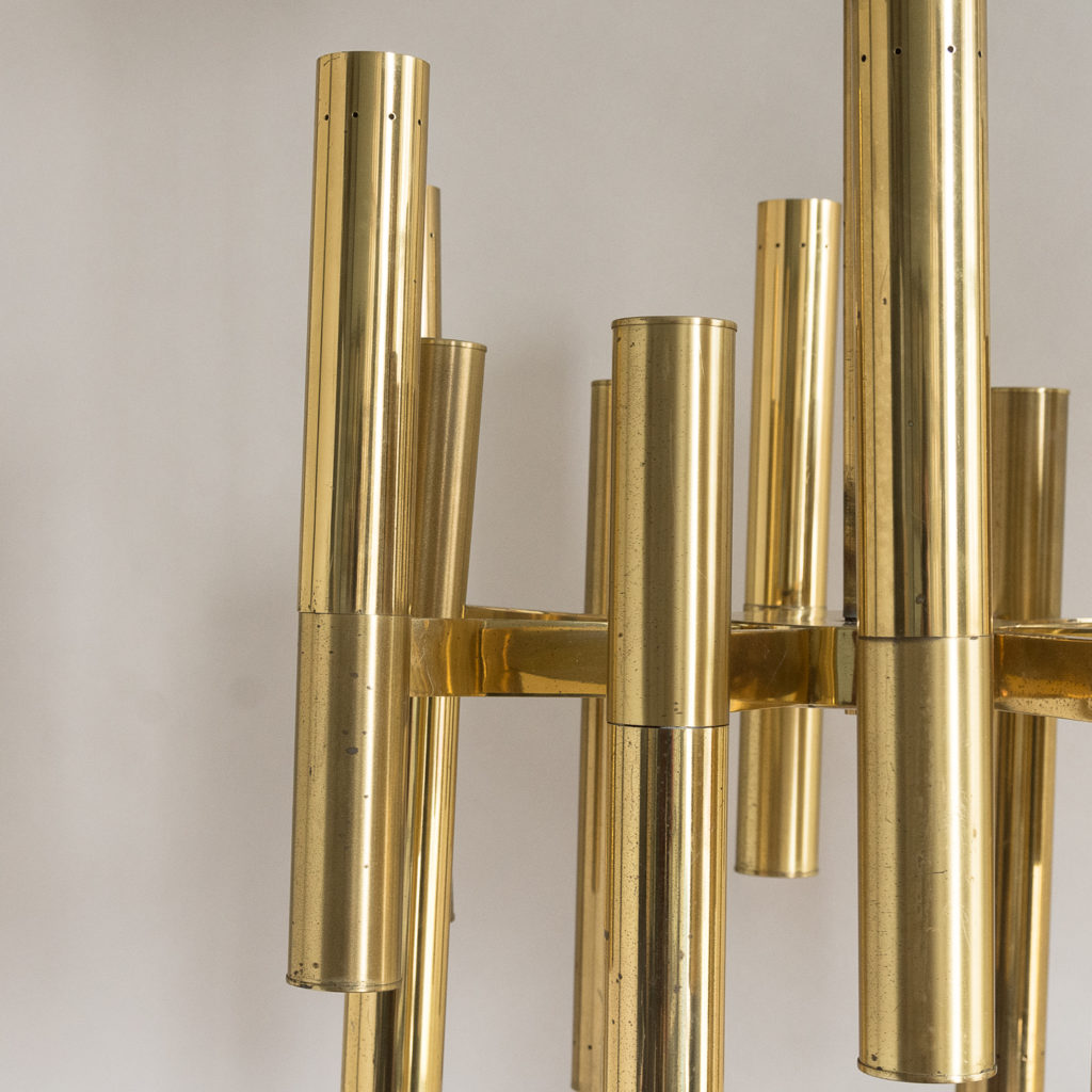 the twelve tubes alternatively illuminating ceiling and floor bound,