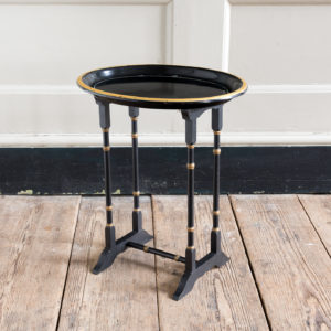 Victorian style ebonised and parcel-gilt tray top table