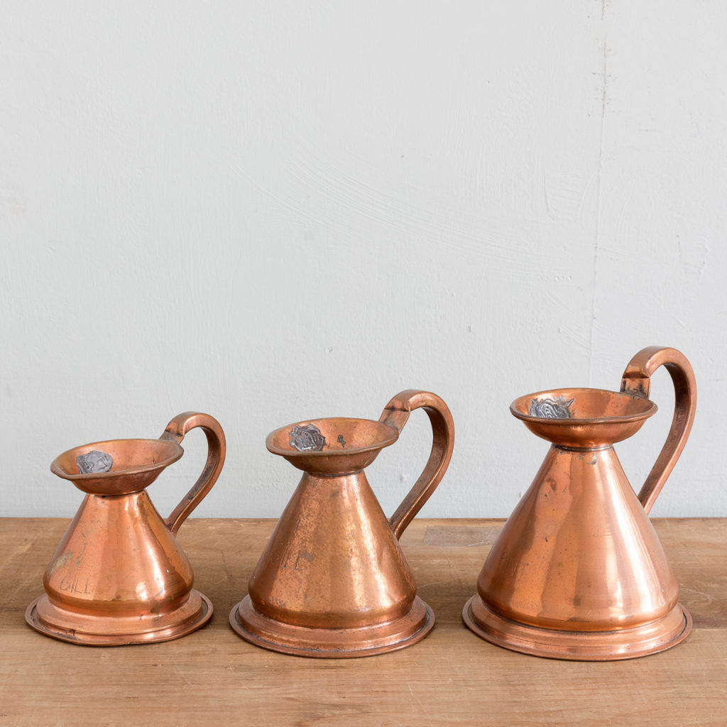 Graduated Victorian copper measuring jugs