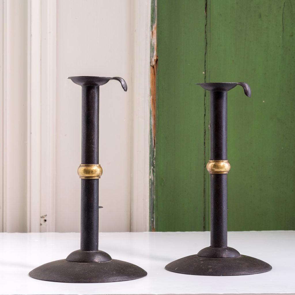 Sheet iron and brass collared hog scrapper candlesticks