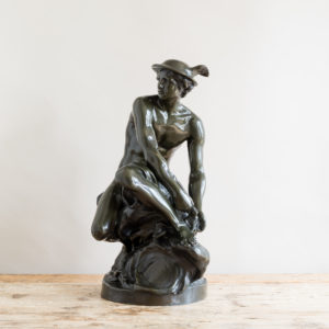 Bronze modelled on a seated Mercury by Jean-Baptiste Pigalle