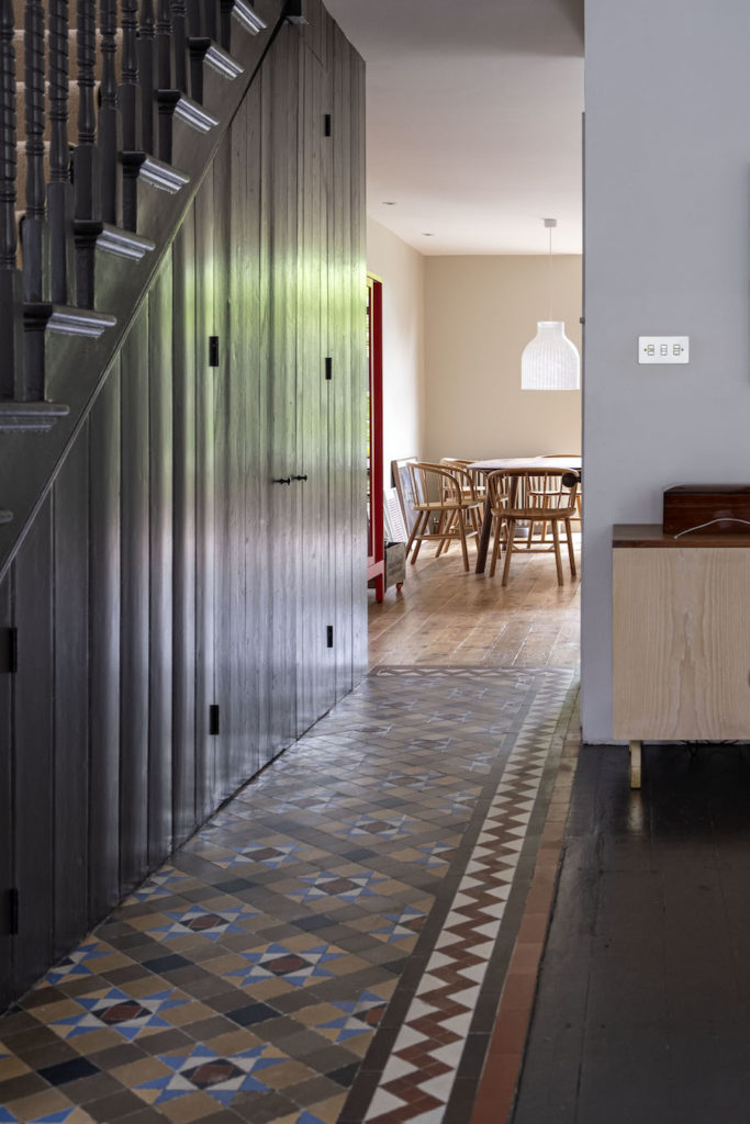hallway with matchboard pine cladding