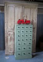 A bank of pine workshop drawers,