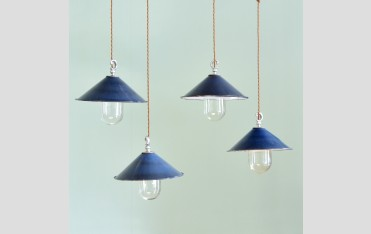 Small blue enamel pendant lights, £150 each.