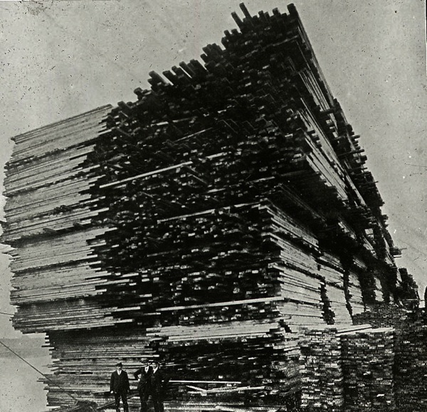 Large stack of reclaimed pine in Victorian times