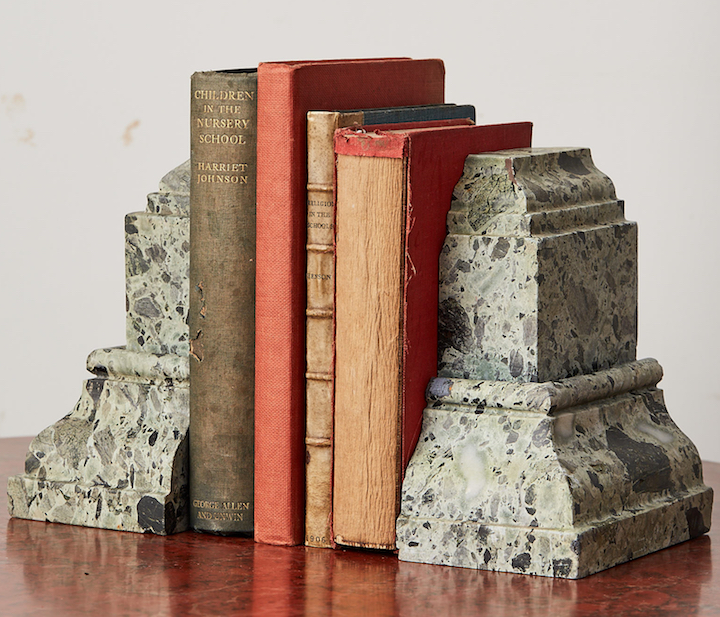 Green marble bookends containing books